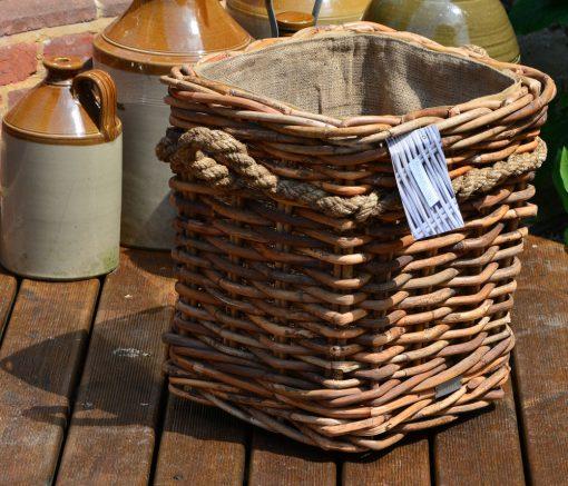 10/7015 Square Natural Ce el Lined Rope Handle Wheeled Log Basket Display